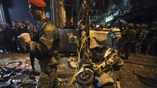 The remnants of a motorbike used in the attacks are seen on the street in southern Beirut.