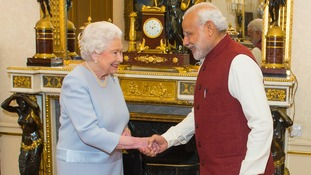 The Queen and the Indian Prime Minister shake hands at Buckingham Palace.