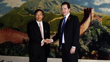 Chancellor George Osborne shakes hands with Yi Gang, vice-president of People's Bank of China after a meeting in Beijing in 2010