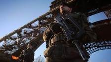 Soldiers underneath the Eiffel tower