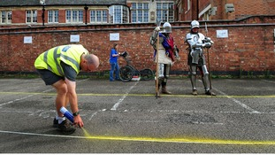 Claire Graham uses ground penetration radar watched by actors dressed as Knights from Historic Equitation Ltd