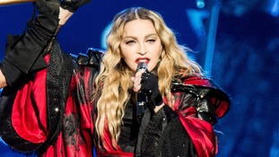 Emotional Madonna asks concert crowd to hold moment's silence for Paris victims