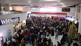 Travellers queuing at Gatwick's North terminal after the evacuation.