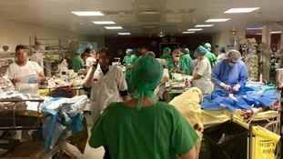 Surgeons and patients in a packed hospital