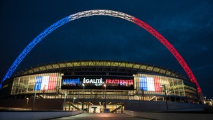 Wembley Stadium lit up in tribute to the Paris terror attacks.