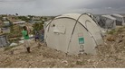Residents of a camp for displaced people of the 2010 earthquake remain in their camp asf tropical storm Isaac bears down on Port au Prince