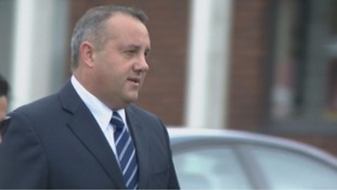 A fireman who was the landlord of a house in Prestatyn has gone on trial accused of manslaughter