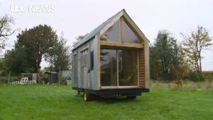This eco-friendly cabin is home to two people in Herefordshire. It was built from recycled materials for less than £1,500.