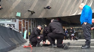 Officers carrying out security checks outside Birmingham New Street yesterday.