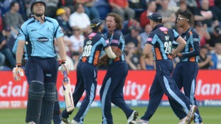Yorkshire's Ryan Sidebottom celebrates with team-mates after bowling out Sussex's Luke Wright