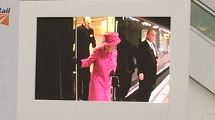 The Queen and Prince Philip on a big screen in the station
