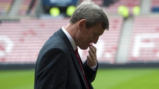 Sunderland's chariman Ellis Short inspects the pitch