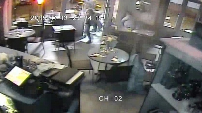 The restaurant's main camera shows people sprinting through the door amid the gunfire outside.