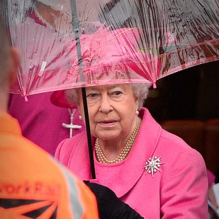 The Queen wouldn't let it rain on her parade through Birmingham this morning.