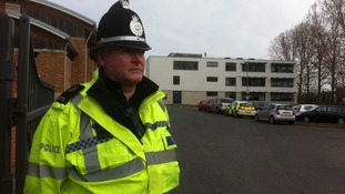 Police guard the entrance to the Haybridge High School and Sixth Form this morning
