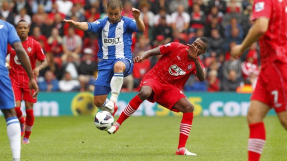 Wigan's Shaun Maloney (left) in action against Southampton's Guly Do Prado