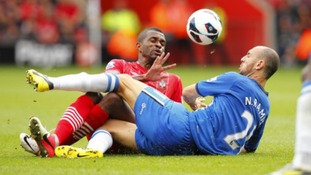 Wigan's Ivan Ramis in action against Southampton's Guly Do Prado (left)