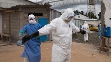 A health worker is disinfected outside the Island Clinic in Monrovia.
