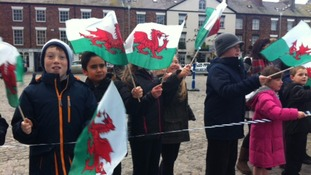 Children from Ysgol Santes Helen waiting for the Duke and Duchess of Cambridge.