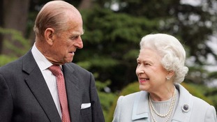 The Queen and Prince Philip smile at each other
