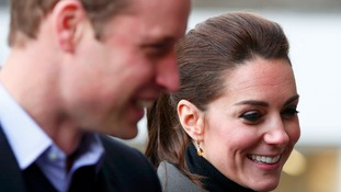 All smiles as the royal couple arrive in Caernarfon.