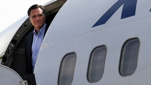 Republican presidential candidate and former Massachusetts Governor Romney waits to get off his campaign plane upon arriving in Portsmouth