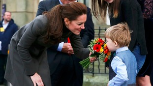 Duchess of Cambridge receives flowers from a bold member of the crowd!