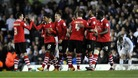 Forest players congratulate Garath McCleary (second from the left) after he scores his side&#x27;s fourth goal against Leeds. 