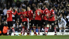 Forest players congratulate Garath McCleary (second from the left) after he scores his side's fourth goal against Leeds.