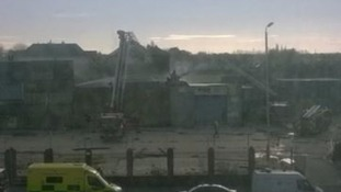 60 firefighters tackle huge fire at warehouse and flats