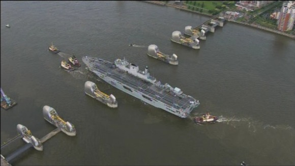 HMS Ocean passes through the Thames