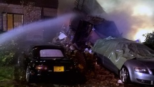 Suspected gas explosion destroys house and leaves two people in hospital
