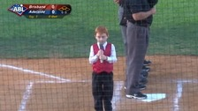 Boy hiccups his way through national anthem at baseball game