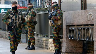 Belgian soldiers patrol outside the European Council headquarters