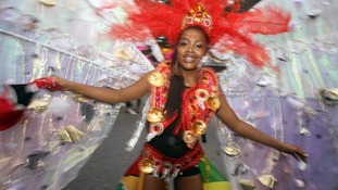 One of the dancers takes part in the Notting Hill Carnival in west London.