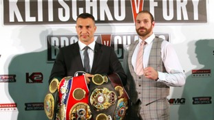 Wladimir Klitschko (left) and Tyson Fury during a press conference at the Hilton Syon Park, London.