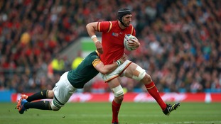 South Africa's Duane Vermeulen tries to bring down Luke Charteris during the Rugby World Cup