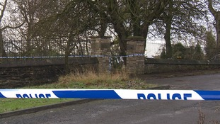 Police tape outside the graveyard