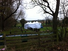 A forensic tent in a graveyard