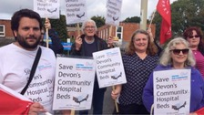 Protesters gather outside Bideford Community Hospital last month