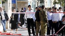 Police secure the area of the stabbing attack in central Jerusalem