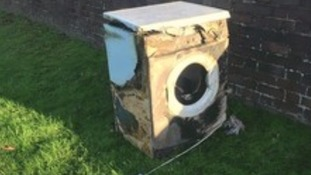 Plumber saves family by carrying burning tumble dryer out of flat
