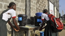 Girls wash their hands in Paynesville, Liberia, where the latest Ebola outbreak has occurred.
