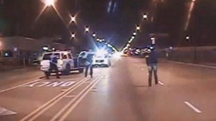 Video of white police officer shooting dead black teenager released