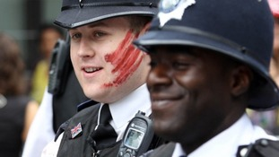 A policeman with paint on his face at the Notting Hill Carnival in west London.