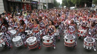 Scores drummed their way through the streets of west London.