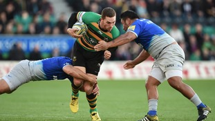 George North running through two defenders