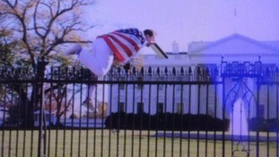 White House on lockdown after man draped in US flag jumps fence