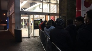Shoppers queue outside a Tesco store in north London.