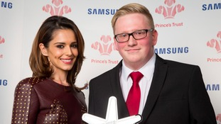 Cheryl Fernandez-Versini and Adrian Maddocks and his award